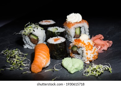 Japanese sushi food. Maki ands rolls with tuna, salmon, shrimp, crab and avocado. Top view of assorted sushi, all you can eat menu. Rainbow sushi roll, uramaki, hosomaki and nigiri.