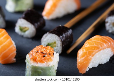Japanese sushi on black background with copy space for text. Soft focus. Asian cousine.