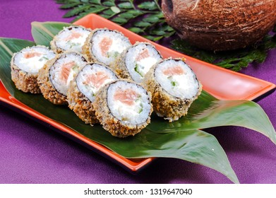 Japanese sushi on a green leaf and stand close up