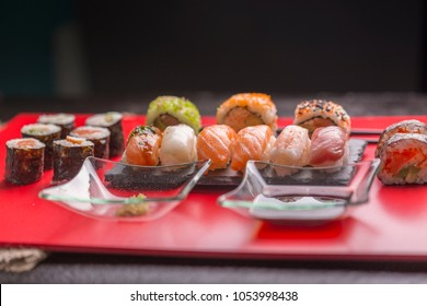 Japanese sushi on a red background. Rolls, Top view. Prepared with rice, salmon and vegetables.