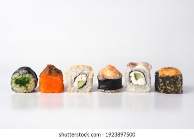 japanese sushi with rice, fish, cream, meat, with different fillings and appearance on a white background