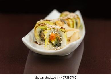 japanese sushi rolls on white plate