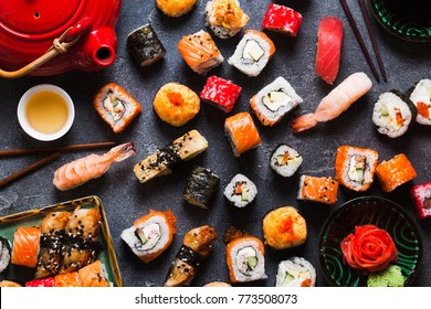 Japanese sushi set nigiri and sushi rolls served with wasabi and ginger, top view