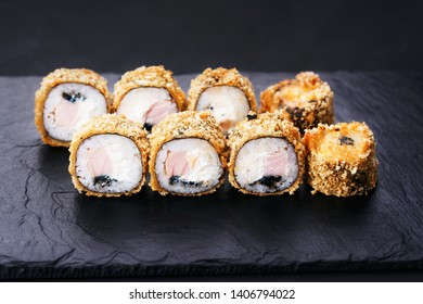 Japanese sushi tempura maki grouper and tobiko roll on  slate. Japanese traditional fusion food style, restaurant menu