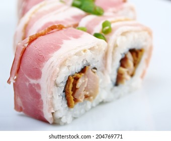 Japanese sushi.Roll made bacon and smoked fish