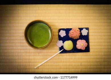 Japanese sweets and green tea that has been placed on the tatami