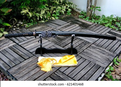 Japanese sword on stand in the garden