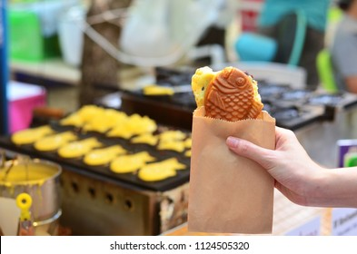 Japanese taiyaki, fish-shaped cake with sweet red bean paste at food street market
