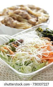 Japanese take out food, Wakame sesweed and vegetable salad with gratin