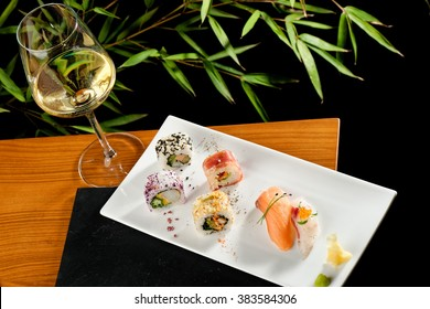 Japanese tasty sushi set with a glas of a wine