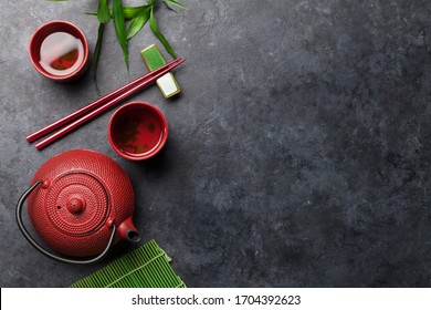 Japanese tea and chopsticks on stone table. Asian food concept. Top view flat lay with copy space
