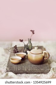 japanese tea. tea party, tea ceremony in Japanese style of wabi Sabi. beautiful composition with kettle, cups and tea leaves. soft selective focus