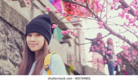 Japanese teenager with blossom flower vintage background