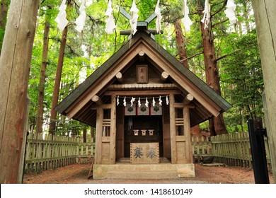 "Japanese text is ""Hotosan Jinja Shrine, Okumiya"". ""Okumiya"" is  rear shrine located behind the main shrine, but dedicated to the same deity. More sacred atmosphere than main. Saitama, Japan."