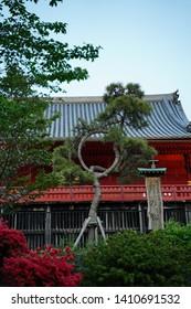 "Japanese text is ""Moon pine tree"", round shaped pine tree. Other texts are ""Hiroshige Utagawa"", Japanese Ukiyo-e artist name and ""Edo hundred views"", his artwork series. Ueno, Tokyo, Japan."