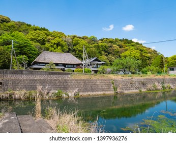 Japanese thatched roofed house is beside a stream in rural area of Saga prefecture, JAPAN.