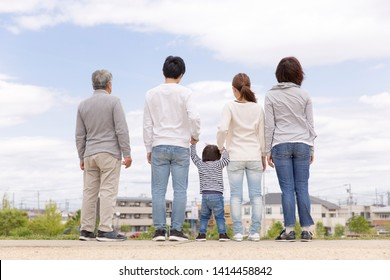 Japanese Three Generation Family Lined in the Park