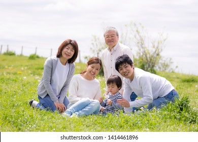 Japanese three generation family playing in the park with grandchildren