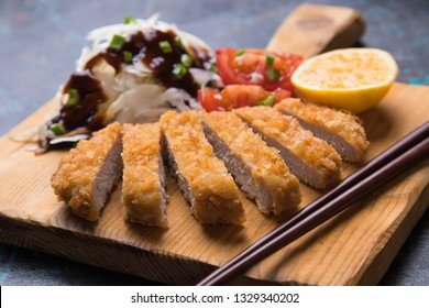 Japanese tonkatsu steak, breaded and fried pork cutlet served with shredded cabbage