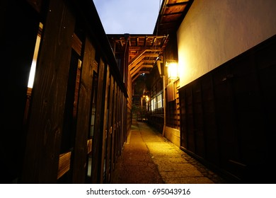 Japanese traditional back alley with porch light at night in Tsumago-juku