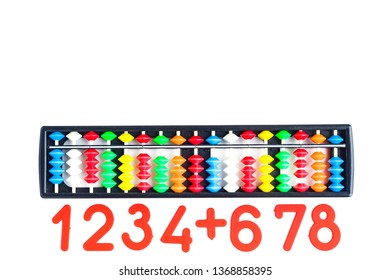 Japanese traditional calculator abacus and numbers on white