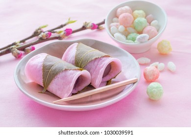 Japanese traditional confectionery, Sakura Mochi wrapped with salted cherry leaves and peach blossoms