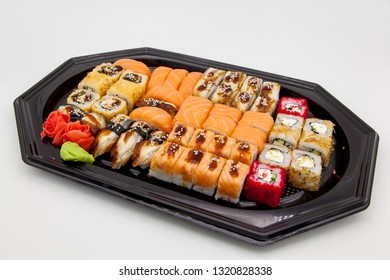 Japanese traditional cuisine, ready-made rolls and sushi in the package, on a white background, for the application and design of fast-food