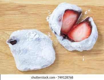Japanese Traditional Dessert, Strawberry Mochi, Ichigo Daifuku or Japanese Rice Cake Made From Glutinous Rice Filled with Red Bean Paste on Wooden Board.