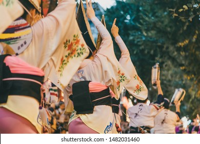 Japanese traditional festive dance event Awa-odori. Performers playing traditional instruments and dancing on the streets of Tokyo during the Kagurazaka festival.