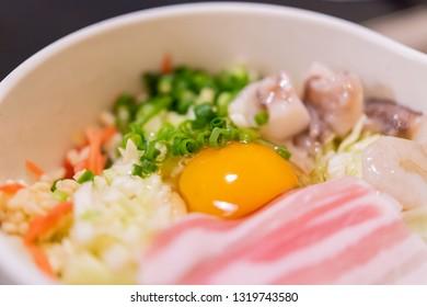 Japanese traditional food Okonomiyaki (Buta-tama)