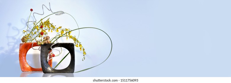Japanese traditional ikebana flower arrangement. Panoramic background with copy space