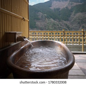 Japanese traditional open air private onsen bathtub with Iya valley autumn view with mountains and forest,  Tokushima, Japan