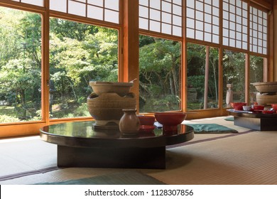 Japanese traditional restaurant room with tatami mat, garden view, Japan