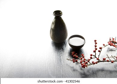 Japanese traditional sake serving set with branch of red fruits