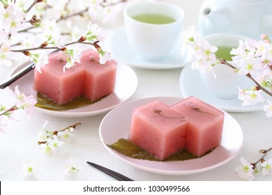 Japanese traditional spring sweet, sweet bean jelly with cherry blossoms  on pale pink plate