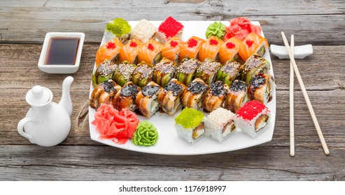 Japanese traditional sushi food and rolls with fresh seafood, on a wooden table