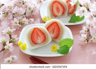 Japanese traditional sweets, Strawberry Daifuku with beautiful cherry blossoms
