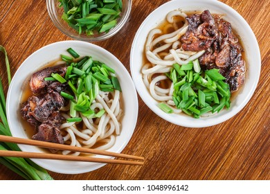 Japanese Udon noodles with beef, green onion and soup in a dish. Top view