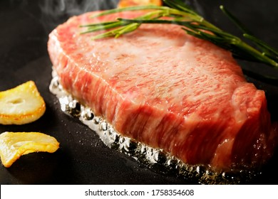 Japanese wagyu beef fillet steak grilled on an iron plate