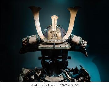 Japanese warrior armor, closed up to helmet part, which was originally worn by Samurai. Shot on dark background.