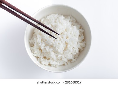 Japanese white rice and wooden chopsticks from above