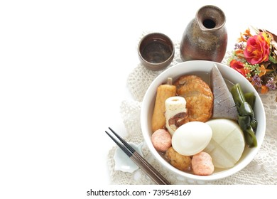 Japanese winter street food, Oden simmered fish cake and radish with Hot Sake drink