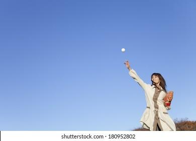 Japanese woman catching a ball