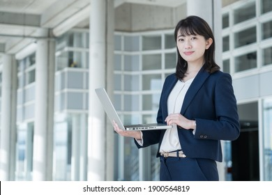 Japanese woman in a dark blue suit