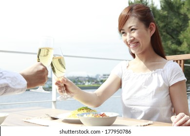 Japanese woman drinking a toast with a Japanese man on the terrace
