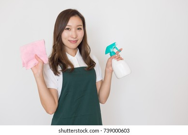 Japanese Woman with dust cloth