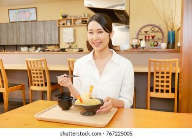 Japanese woman eating at the Japanese tavern