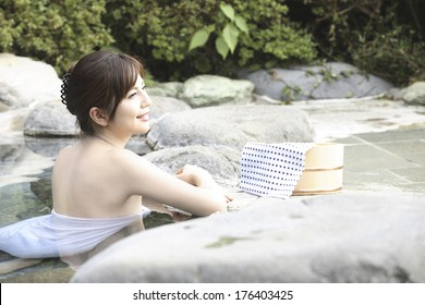 Japanese woman entering the hot spring