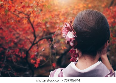 Japanese woman hair style with traditional kimono in autumn japan, Travel concept
