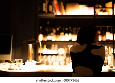 Japanese woman on a date in a fancy bar in Tokyo.